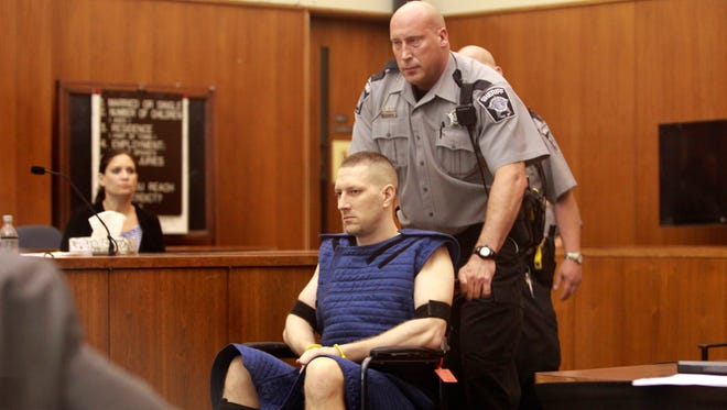 Benjamin G. Sebena is led into the courtroom on Friday