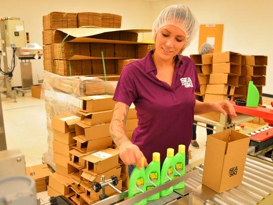 Gabrielle Puma boxes up bottle of spf 50 Sea & Ski