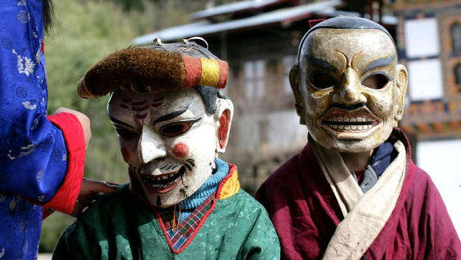 """Two Boys in Masks,"" an image in the ""Vanishing Faces of Bhutan"" exhibit."