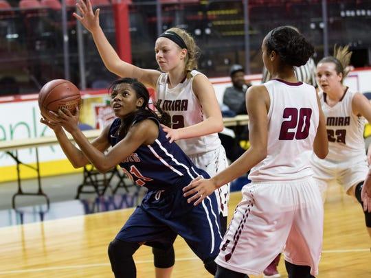 Binghamton's Kaziah Ross cuts between Zaria Demember-Shazer and Alexus Boorse of Elmira in the Section 4 Class AA girls basketball title game Saturday at Floyd L. Maines Veterans Memorial Arena in Binghamton.