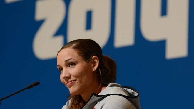 Lolo Jones addresses the media during the USA Women's Bobsled Team press conference prior to the 2014 Sochi Winter Olympic Games at Main Media Center-Tolstoy Hall.