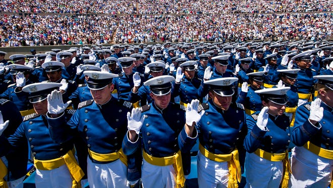 Cadets take the Oath of Office to become 2nd Lieutenants during the graduation ceremony for the United States Air Force Academy class of 2014.