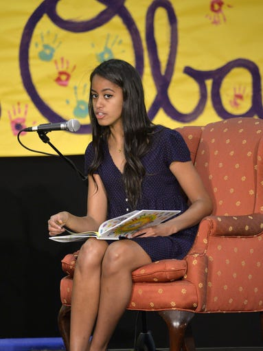 Malia Obama reads fairy tales to children at the United