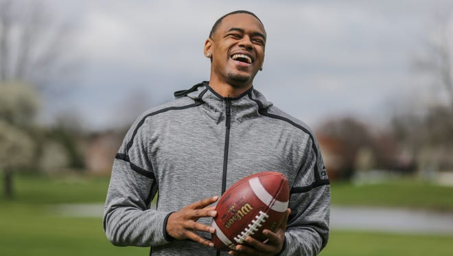 Deontez Alexander tosses a football behind his Greenwood Indiana home on Thursday, April 19, 2018.  Alexander has received significant interest from NFL teams after he decided to pass on Division I offers out of high school due to his father's health, and instead play Division III football at Franklin College while studying Sociology.