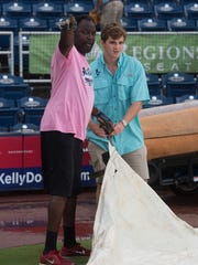 Blue Wahoo Facilities Manager, Mike Crenshaw, left,
