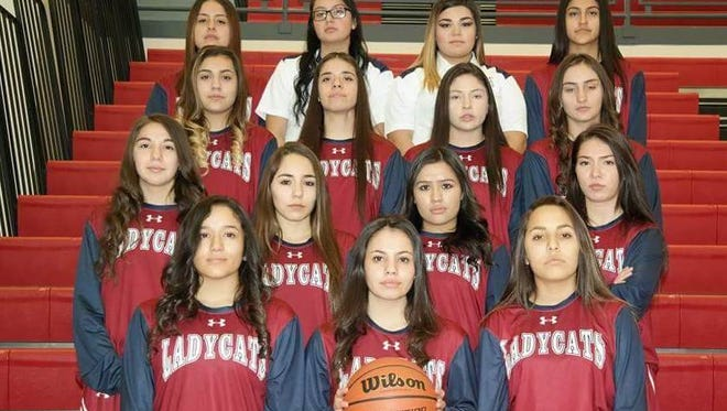 The Deming High Lady Wildcat varsity basketball team qualified for the Class 5A State Playoffs and will travel to top-ranked Los Lunas High for a first-round single elimination game on Friday, March 2. The Lady Cats are, top row, from left, Brianna Camunez, managers Jessica Snyder and Bernice Pacheco and Vanessa Garcia. Second row, from left, Yesenia Flores, Rosa Villagrana, Adriana Giron and Melanie D'Andrea. Third row, from left, Kari Dominguez, Valarie Lopez, Sophia Reyna and Brooke Huerta. Bottom row, from left, Candie Jurado, Alizae Gonzales and Nicole Lopez. Not pictured is Emily Wertz.