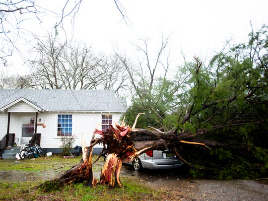 A tree falls on a van on North Broadway in Wetumpka, Ala., during a storm on Saturday, Jan. 21, 2017.
