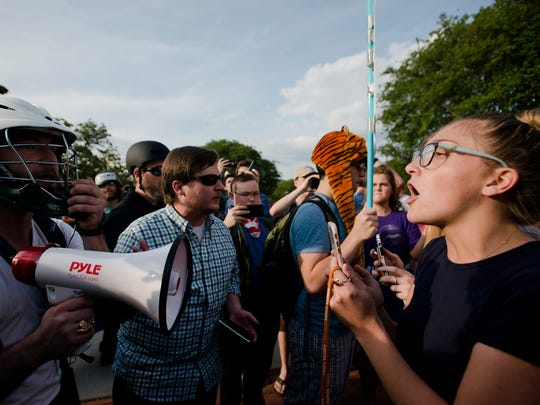 Kimberly Costen, Auburn freshman, right, yells at supports