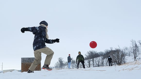 """Hannah DeVries, of the team, """"Menace,"""" kicks the ball while playing against the team """"Pitches be Crazy"""" during the Frozen Leg Kickball tournament as a part of the Media One Funski event Saturday, Jan. 23, 2016, at Great Bear Recreation Park in Sioux Falls. """"It's a lot of the same people coming back every year,"""" said Jeff Morlan, the director for fun of the Frozen Leg Kickball tournament, """"it's awesome."""" The two-day charity event, which started in 1989, has raised over $775,000 for the ChildrenÕs Home Society."""