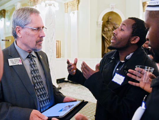 Sen. Phil Jensen (R- Rapid City) speaks with Hassan