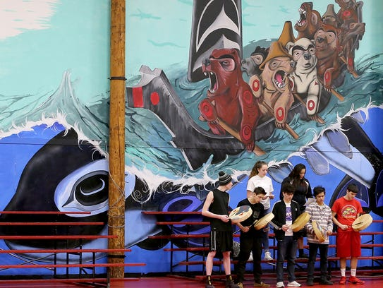 Chief Kitsap Academy students (left to right) Cody McKelvy, 16, Clae-wha-ah Williams, 16, Paisha Carlon, 16, Kanim Natrall, 16, Lucille Schaeffer, 17, Carcione Rabang, 17, and Damian Lawrence, 17, practice their performance piece about Alexander Hamilton.