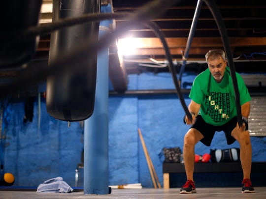 Mark Overby slams battle ropes during a Rock Steady