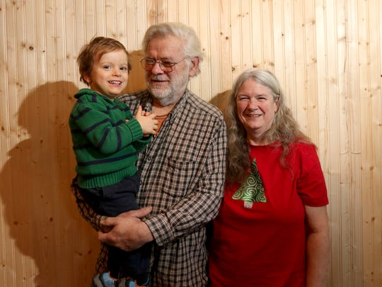 Bill and Cathy Nelson pose with their adopted son,