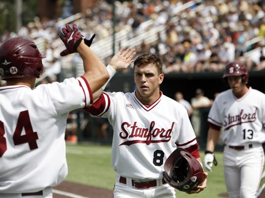 Stanford's Zach Hoffpauir (8) is congratulated by Dominic Jose (34) after he and Austin Slater (13) scored during the fifth inning of an NCAA college baseball tournament super regional game against Vanderbilt Saturday, June 7, 2014, in Nashville, Tenn. (AP Photo/Wade Payne)