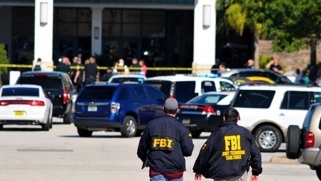 Authorities are seen at the Melbourne Square mall after a shooting in the food court resulted in two deaths and one injuried Saturday, Jan. 17, 2015.