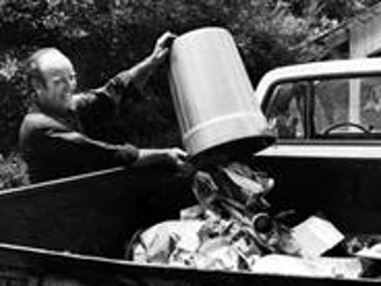 In a July 3, 1974, photograph, Mayor Kyle Testerman does his part as a replacement worker during the city's garbage strike.
