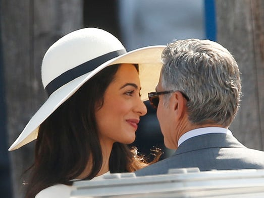 George Clooney and Amal Alamuddin are officially husband and wife! They leave the municipal building after their civil marriage ceremony in Venice, Italy, on Sept. 29. Yes, that's their SECOND marriage ceremony.