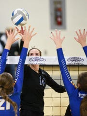 Sioux Falls Christian middle hitter Ellie Voss (14)