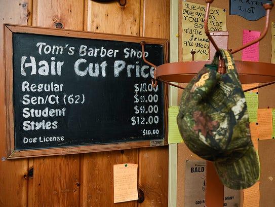 Tom Becker, owner of Toms Barber Shop, has decorated
