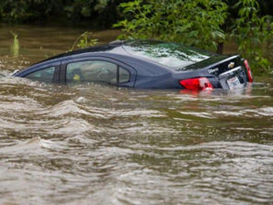 636089444153745755-car-flood.jpg