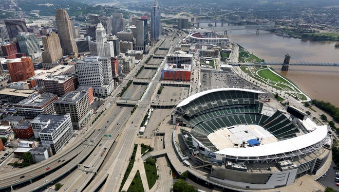 A view of downtown Cincinnati along the Ohio River. The Bengals Paul Brown Stadium is in the foreground and Great American Ballpark in the background.