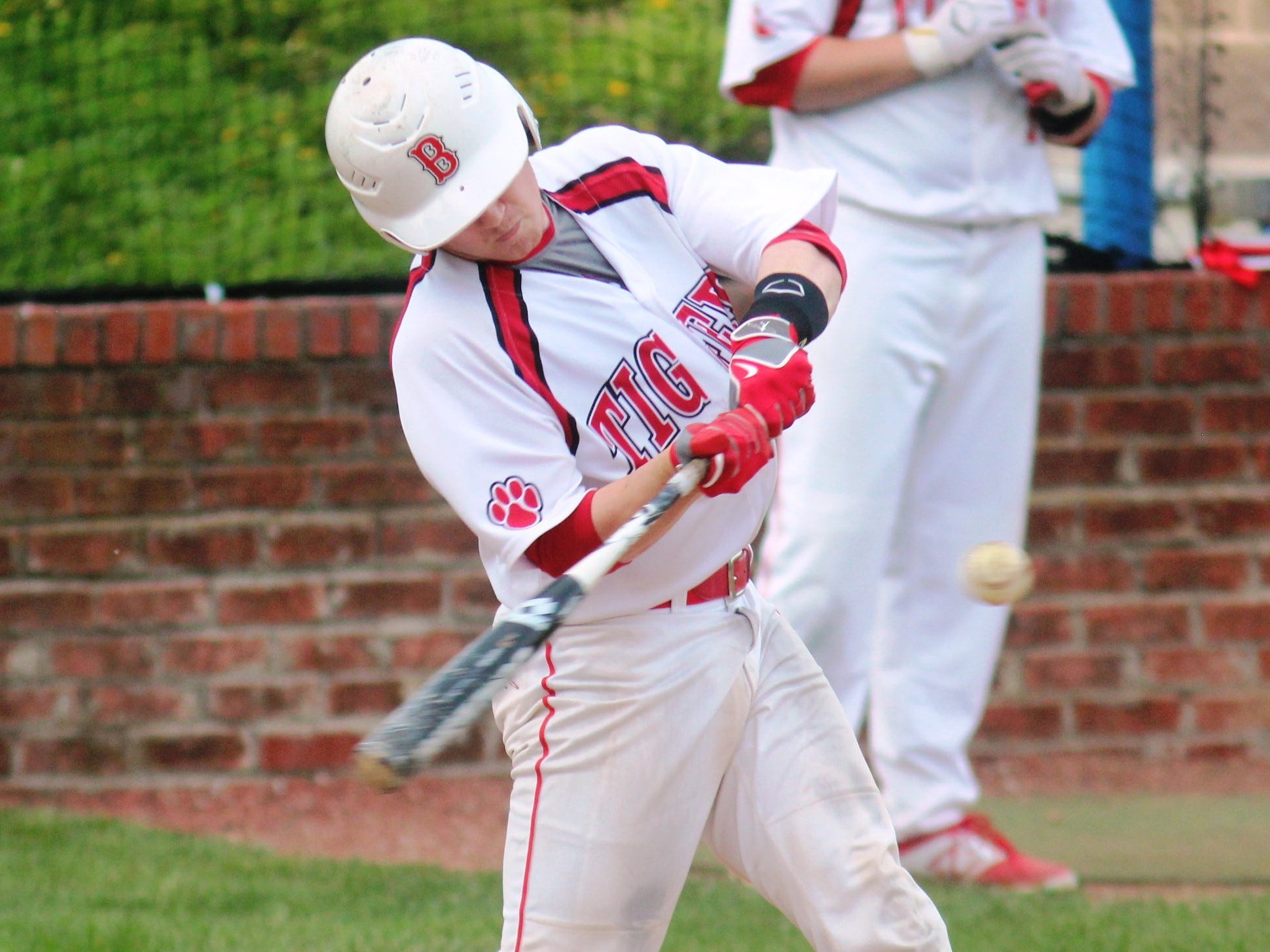 Beechwood senior Jake Schmidt hits the ball.