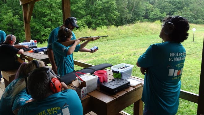Charley Clyne takes aim at targets during practice with the Steel Ringers at the McCoskey Memorial Range at the Ross County Conservation League on July 6.