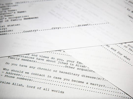 A translated copy of an application to join Osama bin Laden's terrorist network is photographed in Washington, Wednesday, May 20, 2015. The document is among 100 realized by U.S. intelligence officials.