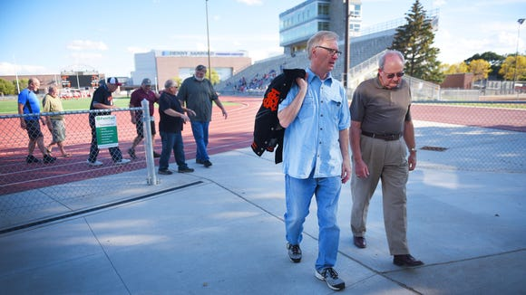 Gary Hanson and Chuck Haugland walk to the field house