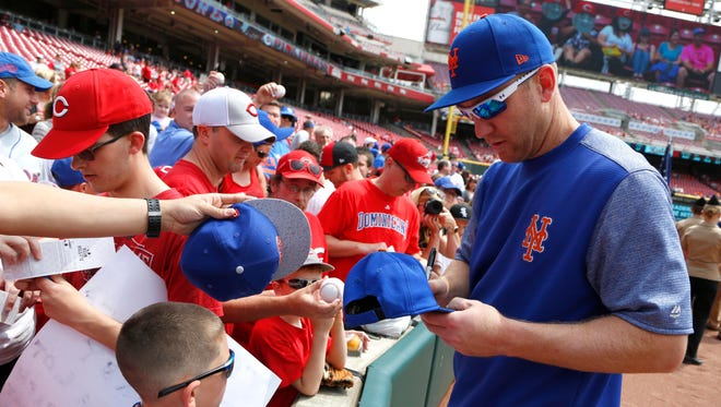 New York Mets third baseman Todd Frazier signs autographs before a game against the Cincinnati Reds at Great American Ball Park.
