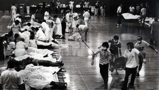Teenagers from Fort Thomas volunteer to carry bodies from the Beverly Hills Supper Club fire into a makeshift morgue at the Fort Thomas Armory.