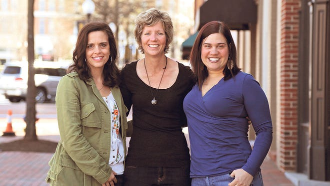 From left, Debbie Clark and Claire Culbreth, owners of Gears in Motion, pose with client Rosanne Bernstein.