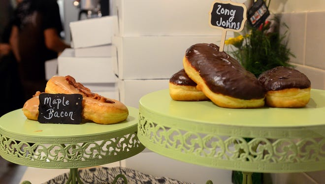 Glazed and Confused will take part in this year's Taste of Downtown. Pictured: Maple bacon and long john donuts.