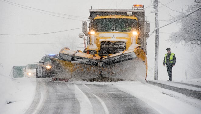 Police stopped traffic on North George Street in Manchester Township so that a plow could clear and salt a hill during the height of Tuesday's snowstorm.