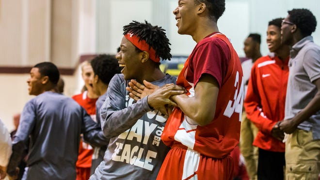 Smyrna players celebrate on the bench after a dunk from Ja'vier Worthy during the Eagles' 71-50 win at St. Elizabeth last Thursday. Smyrna (14-3) moved up to sixth in The News Journal's boys basketball Toip 10.