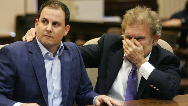 Defense attorney William Kutmus, right, and his client, defendant Alexander Fazzino, react to the not guilty verdict Wednesday, March 9, 2016, in Decorah, Iowa. Jurors on Wednesday found a former Boone man not guilty in the death of his wife, concluding a trial that revolved around whether the woman was strangled or died accidentally before she was found on a bathroom floor.
