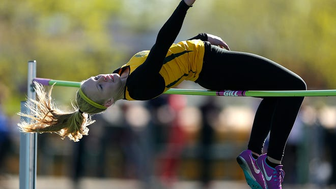 Green Bay Preble senior Jensen Van Duyse clears the bar while competing in the high jump during the FRCC track and field championship meet at Ashwaubenon  on Tuesday. Van Duyse won the event and broke the school record in winning the pole vault.