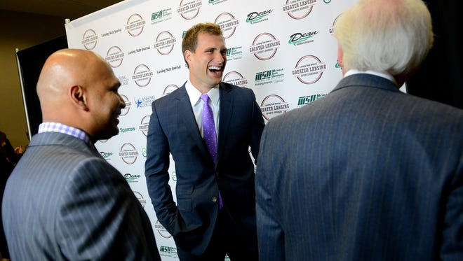 Washington Redskins and former Spartan quarterback Kirk Cousins laughs with VIP guests before the start of the Lansing State Journal Greater Lansing Sports Awards Show show Tuesday, June 7, 2016 at the Lansing Center.