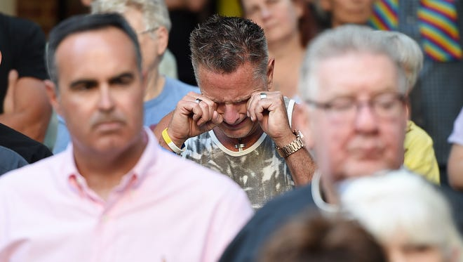 Many hugs and tears were shed as several hundred gathered Sunday evening June 12th for a Vigil at the CAMP Rehoboth Courtyard on Baltimore Avenue in Rehoboth Beach in honor of those slain and injured at the Pulse Nightclub in Orlando, Fla. earlier this morning.