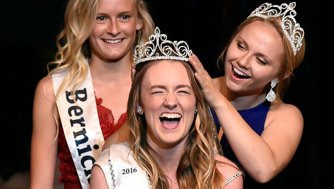Sydney Burk is crowned one of the three Sauk Rapids Community Ambassadors by last years royalty Kelsey Christensen during a coronation ceremony after the competition Thursday, June 23, at the Sauk Rapids-Rice High School.
