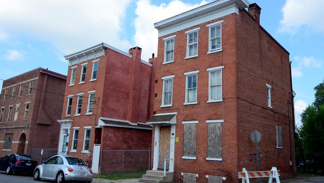 Royal Square Development and Construction last week bought the exclusive rights to look into several abandoned properties on East Princess and South Howard streets. John A. Pavoncello photo