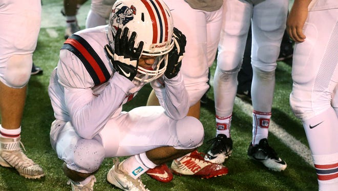 Oakland's senior Brandon Turner (20) reacts to the loss to Whitehaven in the 6-A State Championship Game on Saturday, Dec. 3, 2016, in Cookville, Tenn..
