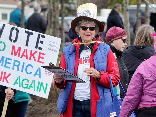 "Donna Branch-Golby of Port Orchard signs up voters at the Silverdale ""March For Our Lives "" protest Saturday."