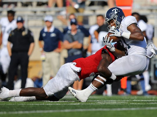 Hoosiers linebacker Tegray Scales nailsGeorgia Southern Eagles running back Wesley Fields  on Sept. 23, 2017;