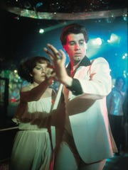 "John Travolta stars in the 1977 blockbuster hit ""Saturday Night Fever."""