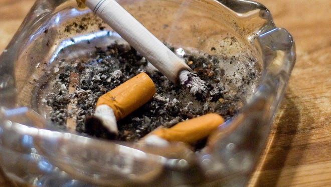 File photo: A cigarette smolders in an ash tray at Rudy's Bar and Grill in Norwalk on April 24.