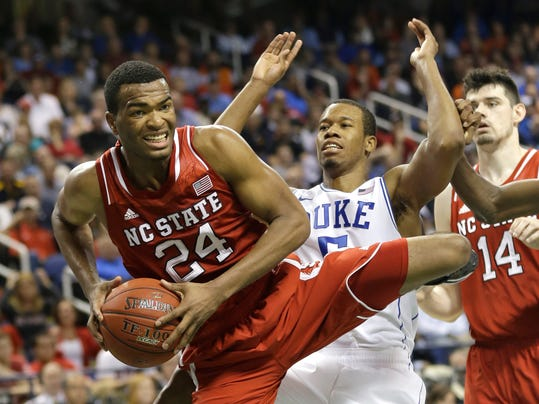 """FILE - In this March 15, 2014 file photo, North Carolina State's T.J. Warren (24) grabs a rebound against Duke's Rodney Hood (5) during the second half of an NCAA college basketball game in the semifinals of the Atlantic Coast Conference tournament in Greensboro, N.C. Warren is taking his high-scoring game to the NBA. In a statement released by the school Tuesday, April 8, 2014, the Atlantic Coast Conference's player of the year said he had """"a fun ride"""" but was ready to enter the NBA draft. (AP Photo/Gerry Broome, File)"""