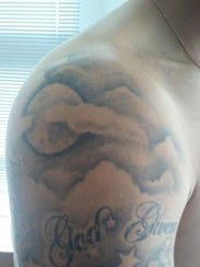Clouds and a moon are tattooed on Riley Ferguson's