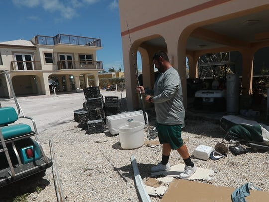 Charter and commercial fisherman Alex Hernandez pulls a few things from his damaged mobile home on Long Key. With the help from friends, they were grabbing anything still left that would have value to his fishing business because once they start to let everyone in they feel like the looting will start. Hernandez will look to a construction job to help pay the bills until the fishing industry comes back. He feels like it will be a couple months, maybe longer, before that happens.