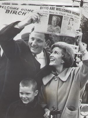 Birch Bayh Jr. newly elected US senator from Indiana was welcomed in his home town of Terre Haute, Nov. 1962.  Wife Marvella and son Evan are with him.